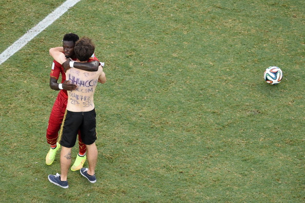 A pitch invader interacts with Sulley Muntari of Ghana during the 2014 FIFA World Cup Brazil Group G match between Germany and Ghana at Castelao on June 21, 2014 in Fortaleza, Brazil.  (credit: Pool/Getty Images)