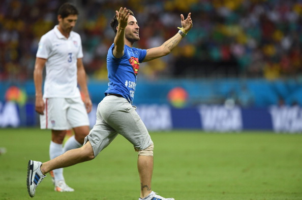 A pitch invader runs on the playing surface during a Round of 16 football match between Belgium and USA at Fonte Nova Arena in Salvador during the 2014 FIFA World Cup on July 1, 2014.   (credit: FRANCISCO LEONG/AFP/Getty Images)