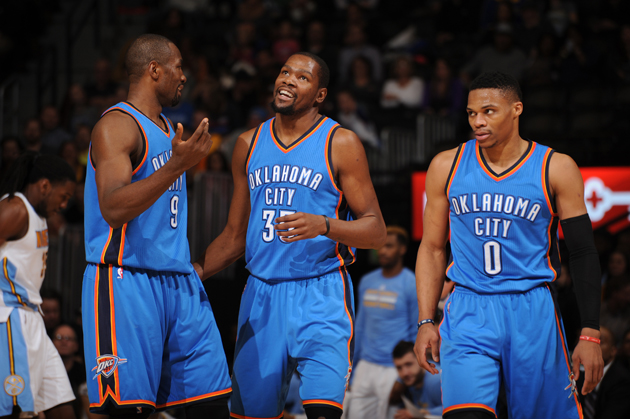 Serge Ibaka #9 of the Oklahoma City Thunder, Kevin Durant #35 of the Oklahoma City Thunder and Russell Westbrook #0 of the Oklahoma City Thunder talk during the game against the Denver Nuggets.