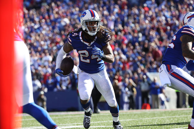 Stephon Gilmore #24 of the Buffalo Bills returns an interception against the Arizona Cardinals during the second half at New Era Field on September 25, 2016 in Orchard Park, New York.