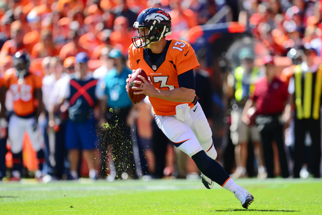 Quarterback Trevor Siemian #13 of the Denver Broncos rolls out and throws a completion in the first quarter of the game against the Indianapolis Colts at Sports Authority Field at Mile High on September 18, 2016 in Denver, Colorado.
