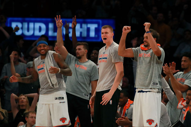 The New York Knicks bench reacts after a basket against the Boston Celtics during the second half of their preseason game at Madison Square Garden on October 15, 2016 in New York City.