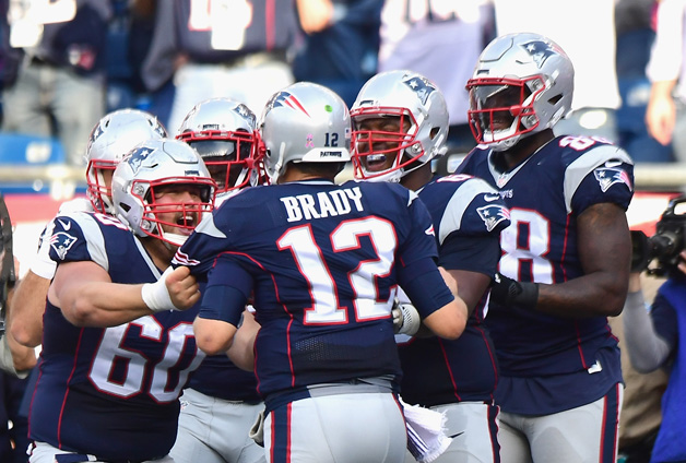 LeGarrette Blount #29 of the New England Patriots reacts with Tom Brady #12 after scoring a touchdown during the fourth quarter of a game against the Cincinnati Bengals at Gillette Stadium on October 16, 2016 in Foxboro, Massachusetts.