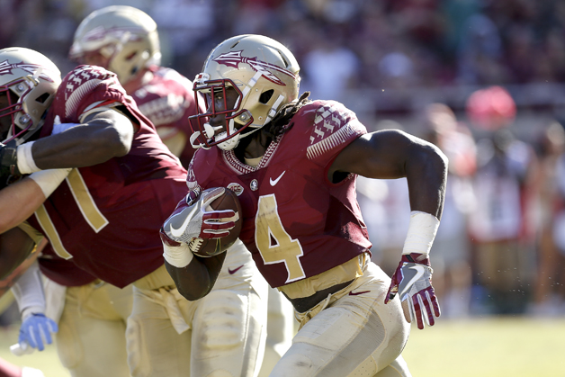 unning back Dalvin Cook #4 of the Florida State Seminoles on a running play during the game against the North Carolina Tar Heels at Doak Campbell Stadium on Bobby Bowden Field on October 1, 2016 in Tallahassee, Florida. North Carolina upset the 12th ranked Florida State 37 to 35.