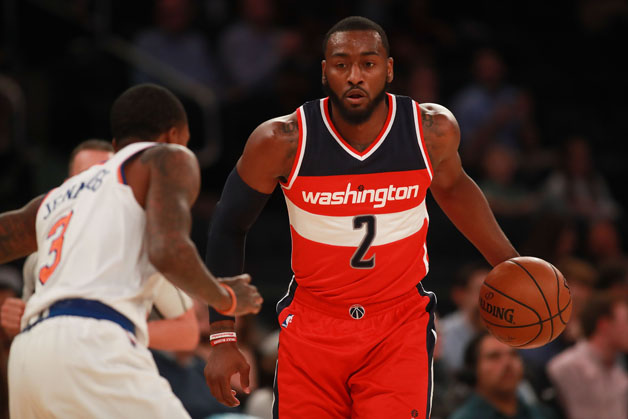 John Wall #2 of the Washington Wizards dribbles up court against Brandon Jennings #3 of the New York Knicks in the first half of the preseason game at Madison Square Garden on October 10, 2016 in New York City.
