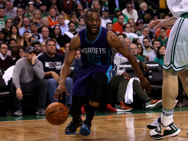 Kemba Walker #15 of the Charlotte Hornets drives with the ball against the Boston Celtics in the first half at TD Garden on April 11, 2016 in Boston, Massachusetts.