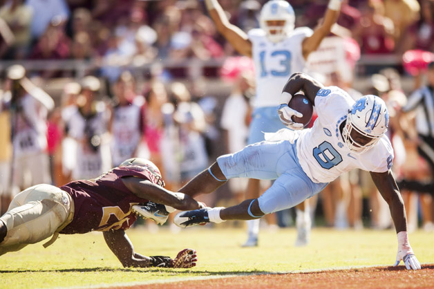 T.J. Logan #8 of the North Carolina Tar Heels scores a touchdown against the Florida State Seminoles during the game at Doak Campbell Stadium on October 1, 2016 in Tallahassee, Florida.