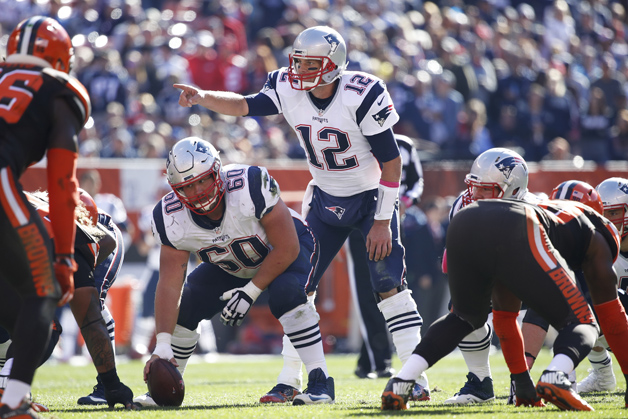 Tom Brady #12 of the New England Patriots directs the offense in the fourth quarter of the game against the Cleveland Browns at FirstEnergy Stadium on October 9, 2016 in Cleveland, Ohio.