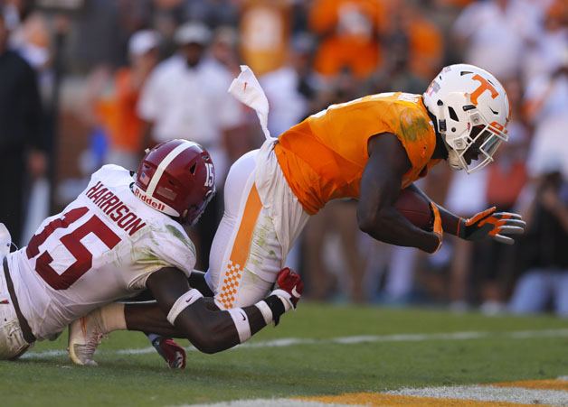 Alvin Kamara #6 of the Tennessee Volunteers rushes for a touchdown against Ronnie Harrison #15 of the Alabama Crimson Tide at Neyland Stadium on October 15, 2016 in Knoxville, Tennessee.