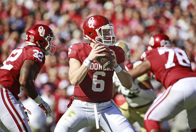 Quarterback Baker Mayfield #6 of the Oklahoma Sooners looks to throw against the Baylor Bears November 12, 2016 at Gaylord Family-Oklahoma Memorial Stadium in Norman, Oklahoma. Oklahoma defeated Baylor 45-24.