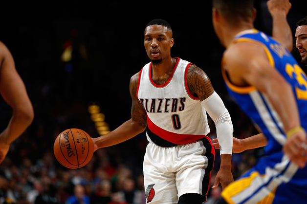 Damian Lillard #0 of the Portland Trail Blazers dribbles the ball against the Golden State Warriors at Moda Center on November 1, 2016 in Portland, Oregon.