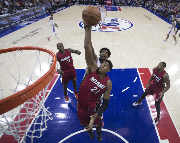 Hassan Whiteside #21 of the Miami Heat and Joel Embiid #21 of the Philadelphia 76ers go up for a rebound in the first half at Wells Fargo Center on November 21, 2016 in Philadelphia, Pennsylvania. The 76ers defeated the Heat 101-94.