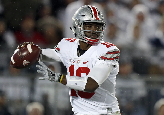 J.T. Barrett #16 of the Ohio State Buckeyes looks to pass in the first half during the game against the Penn State Nittany Lions on October 22, 2016 at Beaver Stadium in State College, Pennsylvania.