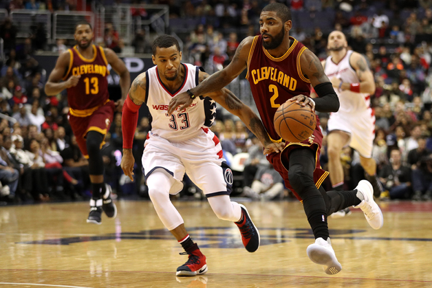 Kyrie Irving #2 of the Cleveland Cavaliers dribbles past Trey Burke #33 of the Washington Wizards during the first half at Verizon Center on November 11, 2016 in Washington, DC