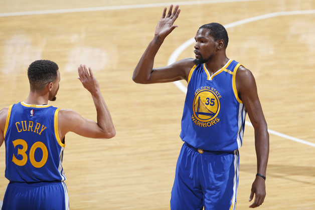 Kevin Durant #35 and Stephen Curry #30 of the Golden State Warriors celebrate during the game against the Indiana Pacers at Bankers Life Fieldhouse on November 21, 2016 in Indianapolis, Indiana. The Warriors defeated the Pacers 120-83.
