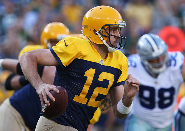 Aaron Rodgers #12 of the Green Bay Packers carries the ball against the Dallas Cowboys during the first quarter at Lambeau Field on October 16, 2016 in Green Bay, Wisconsin.