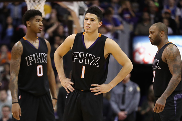 Devin Booker #1 of the Phoenix Suns reacts during the second half of the NBA game against the New York Knicks at Talking Stick Resort Arena on December 13, 2016 in Phoenix, Arizona. The Suns defeated the Knicks 113-111.