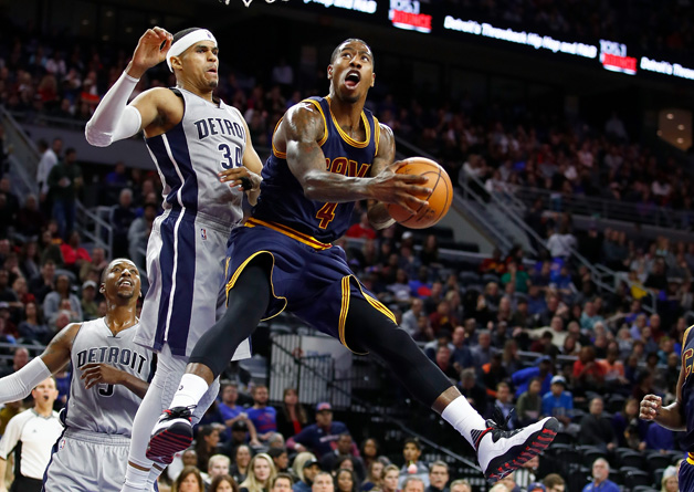 Iman Shumpert #4 of the Cleveland Cavaliers looks to get a shot off around Tobias Harris #34 of the Detroit Pistons during the second half at the Palace of Auburn Hills on December 26, 2016 in Auburn Hills, Michigan. Detroit won the game 106-90.