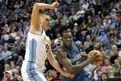 Gorgui Dieng #5 of the Minnesota Timberwolves drives to the basket against Nikola Jokic #15 of the Cenver Nuggets at the Pepsi Center on February 15, 2017 in Denver, Colorado.