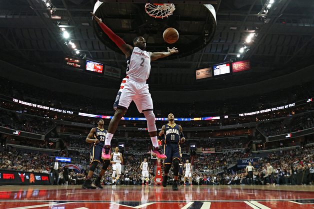 John Wall #2 of the Washington Wizards scores against the Indiana Pacers during the first half at Verizon Center on February 10, 2017 in Washington, DC.