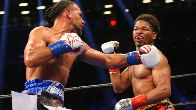 BROOKLYN, NY - JUNE 25: Keith Thurman (left) lands a left hand to the head of Shawn Porter (right) during their 12 round WBA welterweight championship bout at the Barclays Center on June 25, 2016 in the Brooklyn borough of New York City. (Photo by Ed Mulholland/Getty Images)