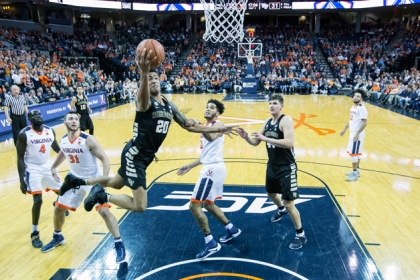 John Collins #20 of the Wake Forest Demon Deacons goes to the basket during Wake Forest's game againt the Virginia Cavaliers at John Paul Jones Arena on January 8, 2017 in Charlottesville, Virginia.