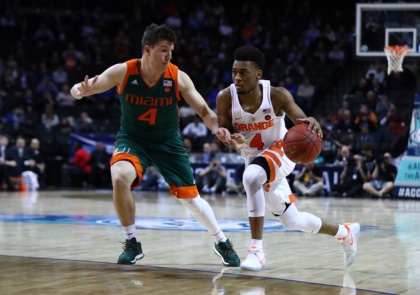 John Gillon #4 of the Syracuse Orange dribbles against Dejan Vasiljevic #4 of the Miami (Fl) Hurricanes during the second round of the ACC Basketball Tournament at the Barclays Center on March 8, 2017 in New York City.