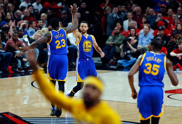 Stephen Curry #30 of the Golden State Warriors celebrates a three point shot with Draymond Green #23 against the Portland Trail Blazers during Game Four of the Western Conference Quarterfinals of the 2017 NBA Playoffs at Moda Center on April 24, 2017 in Portland, Oregon.