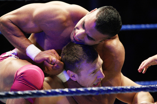 Jinder Mahal puts a headlock on Daniel Bryan during the WWE Smackdown Live Tour at Westridge Park Tennis Stadium on July 08, 2011 in Durban, South Africa.