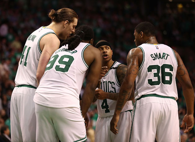 Kelly Olynyk #41, Jae Crowder #99, Isaiah Thomas #4 and Marcus Smart #36 of the Boston Celtics huddle against the Washington Wizards during Game Seven of the NBA Eastern Conference Semi-Finals at TD Garden on May 15, 2017 in Boston, Massachusetts.