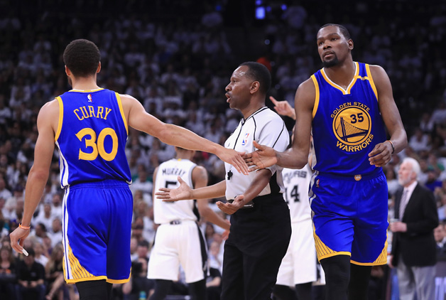 Stephen Curry #30 high fives Kevin Durant #35 of the Golden State Warriors in the first half against the San Antonio Spurs during Game Three of the 2017 NBA Western Conference Finals at AT&T Center on May 20, 2017 in San Antonio, Texas.