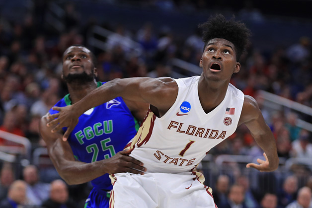 Marc-Eddy Norelia #25 of the Florida Gulf Coast Eagles and Jonathan Isaac #1 of the Florida State Seminoles battle for position during a free throw in the first half during the first round of the 2017 NCAA Men's Basketball Tournament at Amway Center on March 16, 2017 in Orlando, Florida.