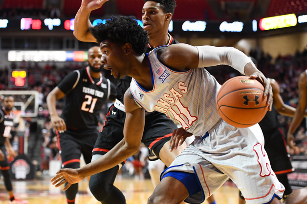 Josh Jackson #11 of the Kansas Jayhawks drives to the basket during the first half of their game against the Texas Tech Red Raiders on February 11, 2017 at United Supermarkets Arena in Lubbock, Texas.