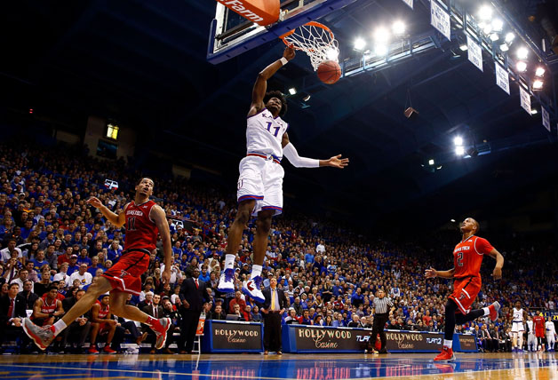 Josh Jackson #11 of the Kansas Jayhawks dunks on a fast break during the game against the Texas Tech Red Raiders at Allen Fieldhouse on January 7, 2017 in Lawrence, Kansas.