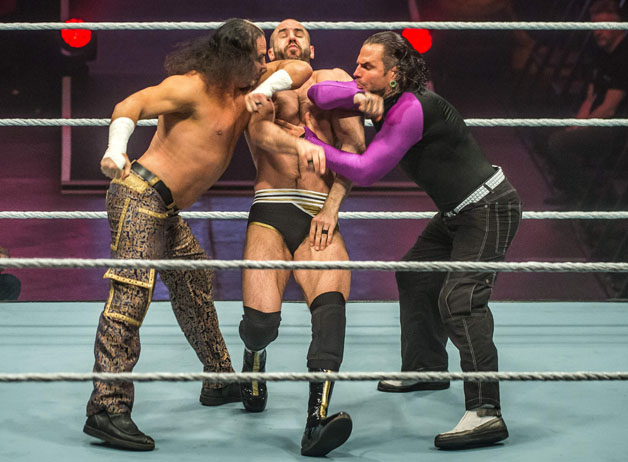 Hardy Boyz and Cesaro (C) battle in the ring during the WWE show at Zenith Arena on May 10, 2017 in Lille, northern France.