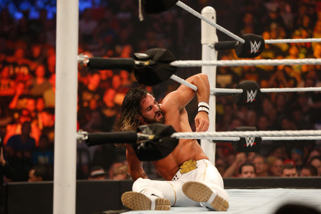 Seth Rollins recovers from a blow during his fight against John Cena at the WWE SummerSlam 2015 at Barclays Center of Brooklyn on August 23, 2015 in New York City.