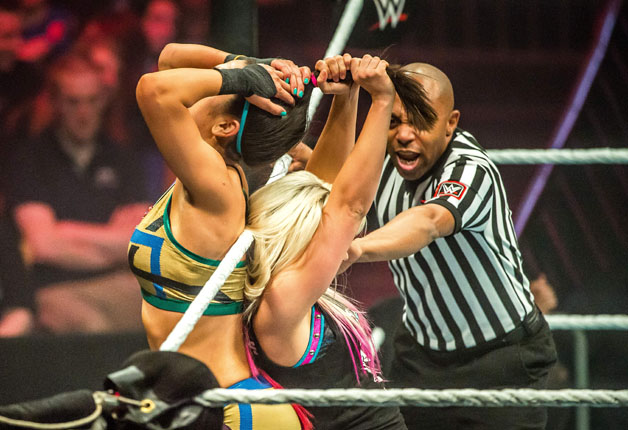 Alexa Bliss (R) and Bayley battle in the ring during the WWE show at Zenith Arena on may 09, 2017 in Lille, France.