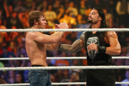 Dean Ambrose and Roman Reigns celebrate their victory at the WWE SummerSlam 2015 at Barclays Center of Brooklyn on August 23, 2015 in New York City.
