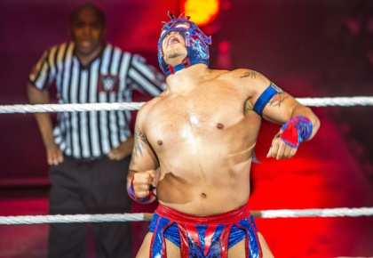 Kalisto celebrates victory during the WWE show at Zenith Arena on may 09, 2017 in Lille, north France.