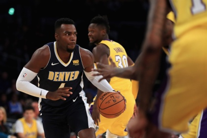 Paul Millsap #4 of the Denver Nuggets dribbles upcourt during the first half of a preseason game against the Los Angeles Lakers at Staples Center on October 2, 2017 in Los Angeles, California.