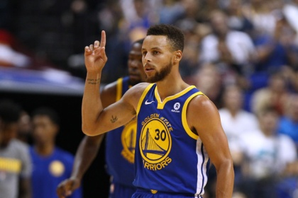 Stephen Curry #30 of the Golden State Warriors celebrates during the game between the Minnesota Timberwolves and the Golden State Warriors as part of 2017 NBA Global Games China at Mercedes-Benz Arena on October 8, 2017 in Shanghai, China.