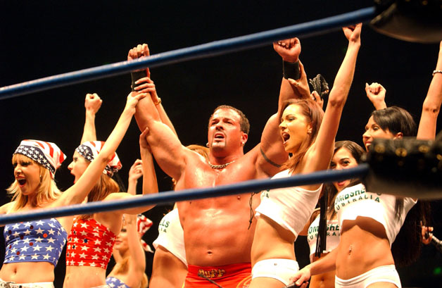 Buff Bagwell and his girls after winning fight during the WWA Wrestling 'Inception' fight night held at the Sydney Superdome, Sydney, Australia.