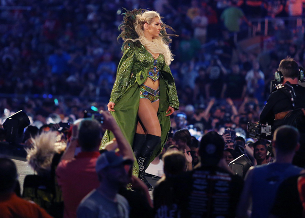 Charlotte Flair walks to the ring during WrestleMania 33 on Sunday, April 2, 2017 at Camping World Stadium in Orlando, Fla.