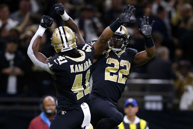 Alvin Kamara #41 of the New Orleans Saints and Mark Ingram #22 celebrate during the second half of the NFC Wild Card playoff game against the Carolina Panthers at the Mercedes-Benz Superdome on January 7, 2018 in New Orleans, Louisiana.