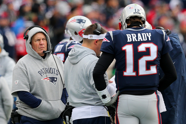 Head coach Bill Belichick of the New England Patriots and Tom Brady #12 on the sideline during the first half against the Buffalo Bills at Gillette Stadium on December 24, 2017 in Foxboro, Massachusetts.
