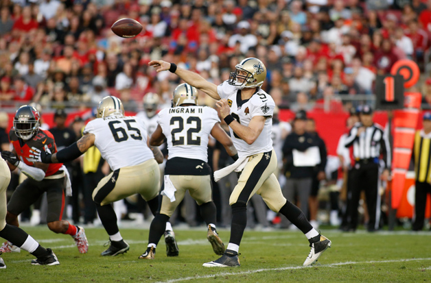Quarterback Drew Brees #9 of the New Orleans Saints throws to an open receiver during the second quarter of an NFL football game against the Tampa Bay Buccaneers on December 31, 2017 at Raymond James Stadium in Tampa, Florida.