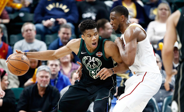 Giannis Antetokounmpo #34 of the Milwaukee Bucks dribbles the ball against the Indiana Pacers during the game at Bankers Life Fieldhouse on January 8, 2018 in Indianapolis, Indiana.