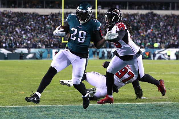 Running back LeGarrette Blount #29 of the Philadelphia Eagles makes a 1-yard rush to score a touchdown against defensive tackle Grady Jarrett #97 and strong safety Kemal Ishmael #36 of the Atlanta Falcons during the second quarter in the NFC Divisional Playoff game at Lincoln Financial Field on January 13, 2018 in Philadelphia, Pennsylvania.