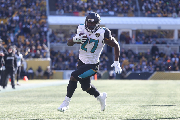 Leonard Fournette #27 of the Jacksonville Jaguars runs for a touchdown against the Pittsburgh Steelers during the first half of the AFC Divisional Playoff game at Heinz Field on January 14, 2018 in Pittsburgh, Pennsylvania.