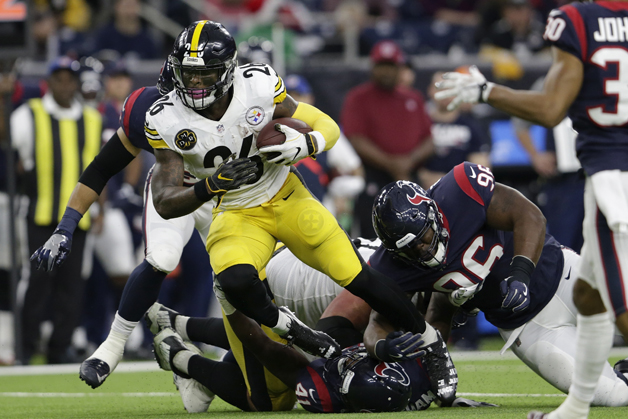Le'Veon Bell #26 of the Pittsburgh Steelers is tripped up by Zach Cunningham #41 of the Houston Texans and Chunky Clements #96 in the second quarter an at NRG Stadium on December 25, 2017 in Houston, Texas.